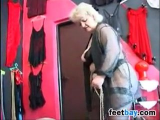 Granny Gets Her Feet Worshipped By A Victim