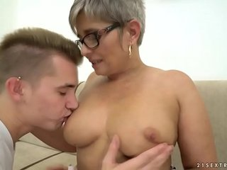 Grandma deepthroats a young huge cock before riding on it