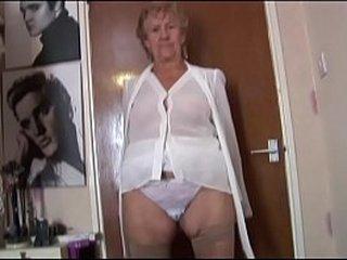 Granny in shear lingerie disrobing