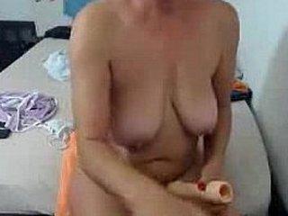 Inexperienced Buxomy Granny Dildoing Hard