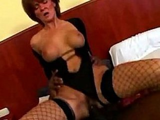 Granny wears fishnet stockings