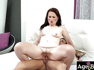 Young man Dom's creamy load on granny Alice's face