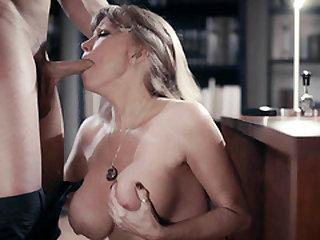 Big hooters GILF Darla Crane seduces her new boss