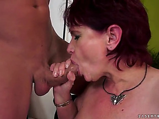 Bewitching granny in stocking giving out oralsex previous to marionette's during the time that being fucked xxx